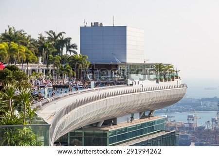 SINGAPORE - FEBRUARY 27, 2015: View of roof top pool at Marina Bay Sands sky garden. Marina Bay is one of the most famous tourist attraction in Singapore.