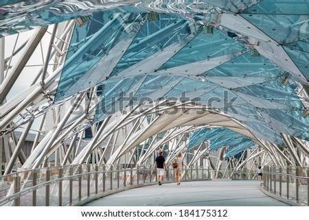 SINGAPORE - FEBRUARY 3 : View of the DNA inspired Helix bridge in Singapore on February 3, 2012, Unidentified people. - stock photo