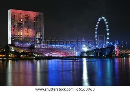 Singapore flyer and river at night