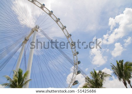 Singapore Flyer in the sunny sky (ferris wheel) - stock photo