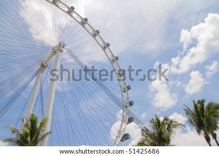 Singapore Flyer in the sunny sky (ferris wheel) - stock photo