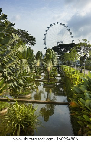 Singapore flyer with Gardens by the Bay - stock photo