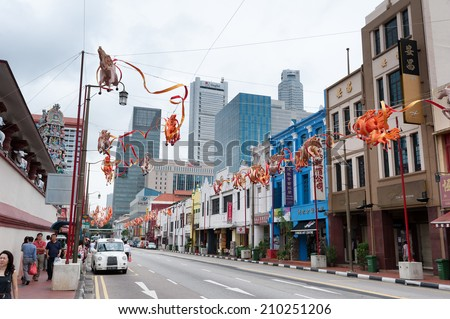 SINGAPORE - 2 JAN, 2014: Chinatown famous district of Singapore. Traditional buildings facades and local culture sights are famous travel attractions  - stock photo