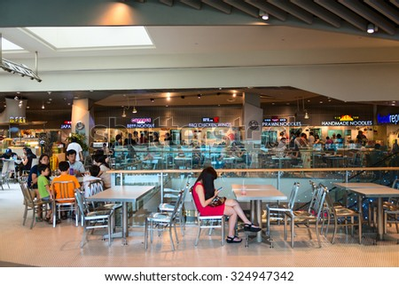 SINGAPORE - 01 JAN 2014: Customers dining in the food court of Orchard Road Shopping Mall, a popular shopping destination in Singapore. - stock photo