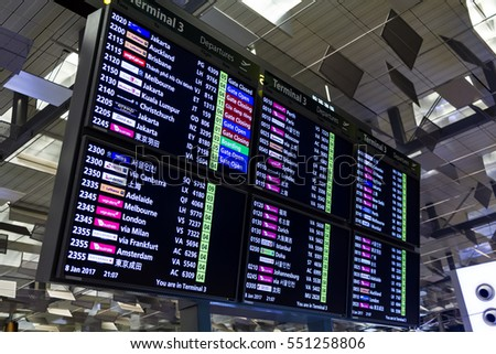 SINGAPORE - JAN 8, 2017: Departure Board in Changi Airport. Departure Hall, it has 3 passenger terminals, and is one of the largest transportation hubs in Asia and serves more than 100 airlines.