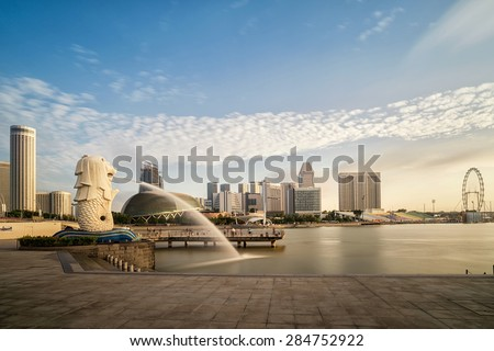 SINGAPORE-JAN 31:The Merlion fountain and Singapore skyline on JAN 31, 2015. Merlion is an imaginary creature with a head of a lion and the body of a fish and is often seen as a symbol of Singapore. - stock photo