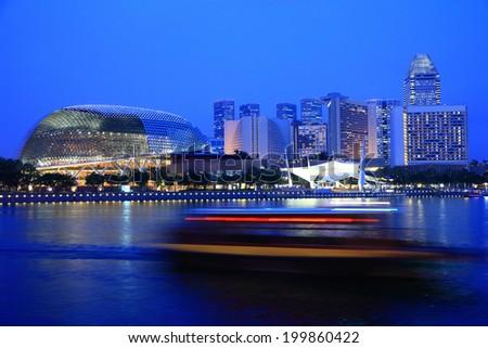 SINGAPORE-JAN 20:Twilight shot of  Esplanade theater at Marina Bay district in Singapore on Jan 20, 2011. Marina Bay district is one of best sightseeing destination in Singapore. - stock photo