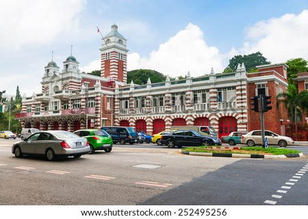SINGAPORE - 02 JAN 2014: Vintage retro central fire station building with red gates and brick walls - stock photo