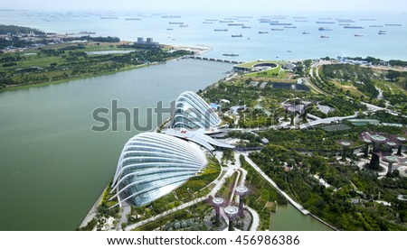 SINGAPORE - JANUARY 6, 2014: Aerial view of Singapore from Marina Bay Sands Sky park. Marina Bay Sands is an integrated resort fronting Marina Bay in Singapore. - stock photo