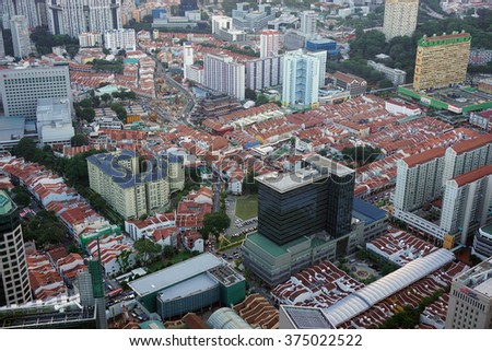 SINGAPORE -23 JANUARY 2016- Birds eye view of the downtown core of Singapore (Central Business District) and the Singapore skyline from the top of a high-rise building.