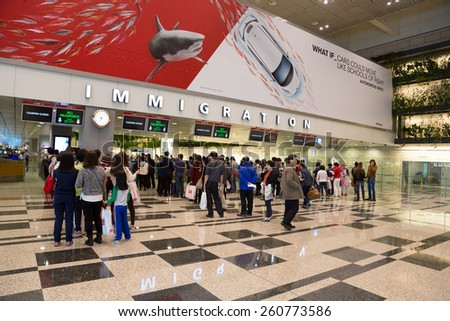 SINGAPORE - JANUARY 26, 2015:  Changi International Airport is a major aviation hub in Asia, serves more than 100 airlines operating 6,100 weekly flights connecting Singapore to over 220 cities.  - stock photo