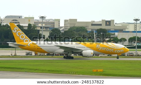 SINGAPORE - JANUARY 10: Scoot low cost carrier Boeing 777-200 taxiing at Changi Airport on January 10, 2015 in Singapore - stock photo