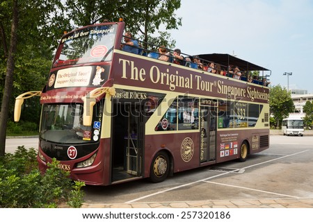 SINGAPORE - JANUARY 26, 2015: Singapore has over 10 million visitors each year. The Original Tour Singapore Sightseeing - this company offering Singapore City bus tours for tourists. - stock photo