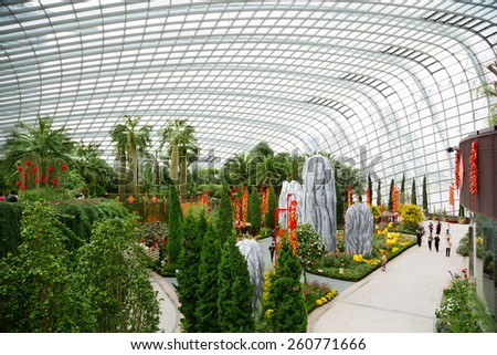 SINGAPORE - JANUARY 27, 2015: The conservatory Flower Dome is located on the territory Park Gardens by the Bay. Park is intended to become Singapore's premier urban outdoor recreation space. - stock photo