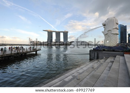 SINGAPORE - JANUARY 25:The Marina Bay Sands Resort stands majestically at the mouth of the Singapore River January 25, 2011 in Singapore. This waterfront resort and casino is a tourist attraction. - stock photo