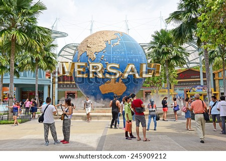 SINGAPORE - JANUARY 5 : Tourists and theme park visitors taking pictures of the large rotating globe fountain in front of Universal Studios on January 5, 2015 in Sentosa island, Singapore. - stock photo