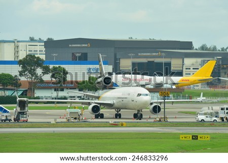 SINGAPORE - JANUARY 10: UPS MD-11F freighter parking at Changi Airport on January 10, 2015 in Singapore - stock photo