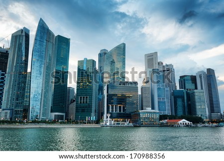 SINGAPORE - JANUARY 2, 2011: View of skyscrapers in Marina Bay in Singapore. Singapore is the world's fourth leading financial centre. - stock photo