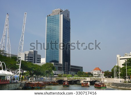 Singapore - Jul 22, 2015. Tall and modern skyscrapers built in business district of Singapore. Singapore's total trade in 2014 amounted to S$982 billion.