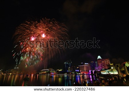 SINGAPORE - July 12: Firework over Marina Bay on July 12, 2014 in Singapore. Singapore is the world's fourth leading financial center.  - stock photo