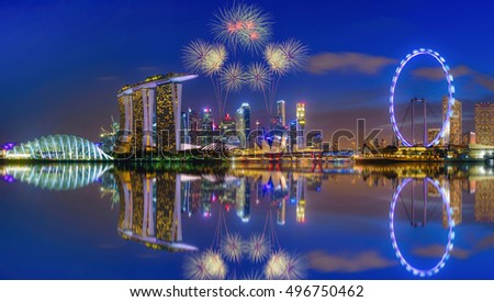 SINGAPORE - JULY 9, 2016 : Firework over Singapore Skyline and view of skyscrapers on Marina Bay at twilight time.