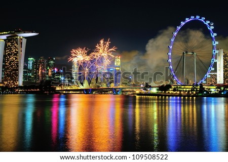 SINGAPORE - JULY 21: Fireworks display captured with Marina Bay city scape during National Day Parade 2012 Rehearsal on July 21, 2012 in Singapore