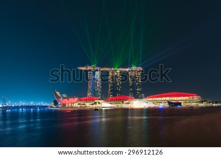 SINGAPORE - JULY 09: laser show at the Marina Bay Sands on July 09, 2015 in Singapore. Marina Bay Sands is an integrated resort and the world's most expensive standalone casino property at S$8 billion