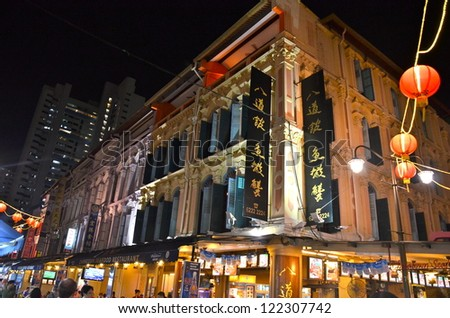 SINGAPORE - JULY 12: Located within the district of Outram, Singapore's Chinatown is an ethnic neighbourhood featuring distinctly Chinese cultural elements. July 12, 2012 in Singapore. - stock photo