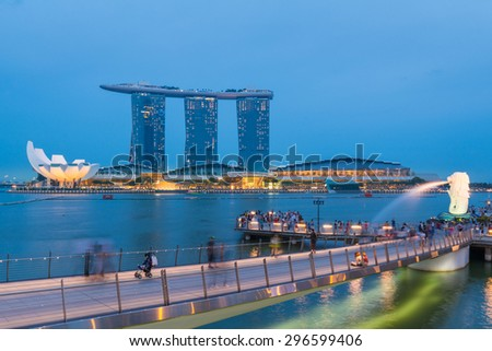 SINGAPORE - JULY 09: The Merlion fountain lit up at night on July 09, 2015 in Singapore. Singapore is a world famous tourist city with highly developed economic infrastructure. - stock photo