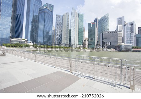 SINGAPORE - JULY 24: View of skyscrapers in Marina Bay on July 24, 2014 in Singapore.  - stock photo