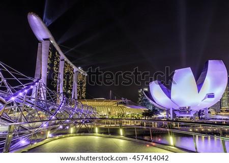 SINGAPORE -July 7: Wonderful laser show at the Marina Bay waterfront in Singapore. Marina Bay Sands Hotel dominates the skyline at Marina Bay on July 7, 2016 - stock photo