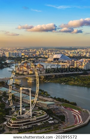 SINGAPORE-JUN 25:Aerial view of Singapore Flyer at Marina Bay district in SINGAPORE on June 25, 2014. Marina Bay is one of best sightseeing destination in Singapore. - stock photo