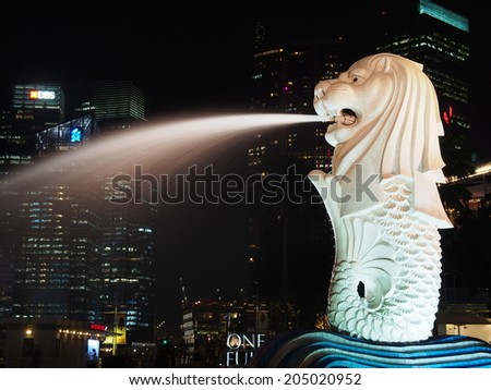 SINGAPORE - JUN 23: The Merlion in Merlion Park on June 23, 2014. The Merlion is a mythical creature with the head of a lion and the body of a fish, used as a mascot of Singapore. - stock photo