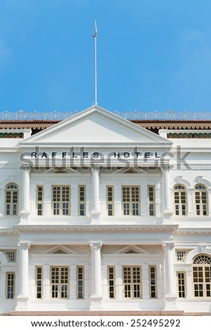 SINGAPORE - 02 JUN 2013: The Raffles Hotel in Singapore. Opened in 1899, it was named after Singapore's founder Sir Stamford Raffles. - stock photo