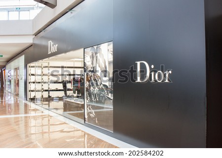 SINGAPORE - JUNE 19: Dior Store in Marina Bay Sands Shopping mall, Singapore on June 19, 2014. It is a French company controlled and chaired by Bernard Arnault who also heads Louis Vuitton. - stock photo
