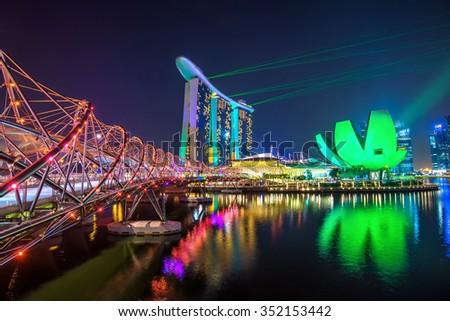 Singapore - June 15,2013 : Laser show of Marina bay sands and Helix Bridge singapore travel landmark - stock photo