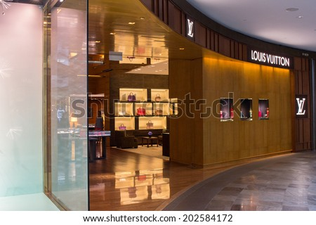 SINGAPORE - JUNE 19: Louis Vuitton Store in Marina Bay Sands Shopping mall, Singapore on June 19, 2014. LV has been named the world's most valuable luxury brand.Its 2012 valuation was 25.9 billion USD - stock photo