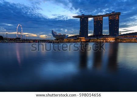 SINGAPORE - June 19, 2016: Marina Bay Sands hotel in the blue hour evening .One of greatest casinos in world and Lotus Architecture highlighted at night in Singapore