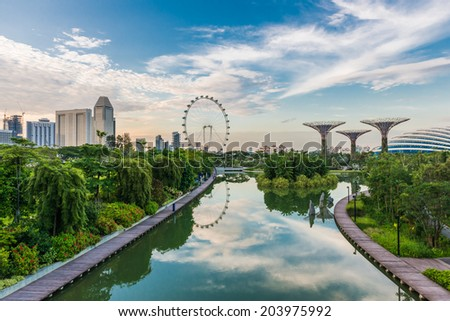 SINGAPORE -JUNE 19: Singapore Flyer - the Largest Ferris Wheel in the World. looking from Gardens by the Bay, Singapore on June 19, 2014 in - stock photo