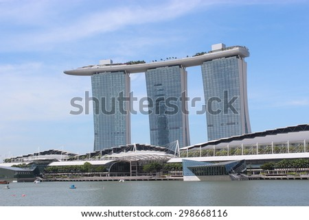 SINGAPORE - June 20: World's most expensive standalone casino property at US$ 6.3 billion. Marina Bay Sands Hotel dominates the skyline at Marina Bay June 20, 2015 in Singapore. - stock photo