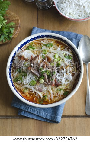 Singapore laksa soup with mixed roast meats - stock photo