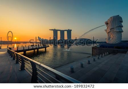 Singapore landmark Merlion with sunrise - stock photo