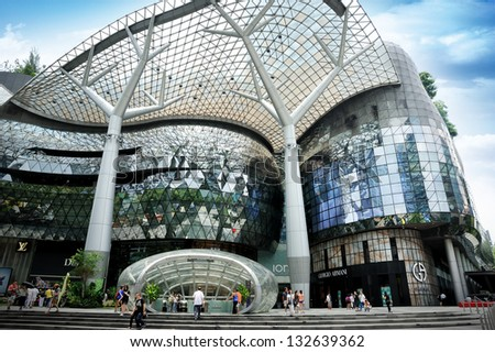 SINGAPORE - MAR 23 : Day view of ION Orchard shopping mall on Mar 23, 2013 in Singapore Orchard Road. The Media Facade is a multi-sensory canvas media wall made with cutting-edge technology. - stock photo