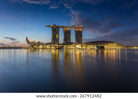 SINGAPORE-MAR 21 : The Merlion and the Marina Bay Sands Resort Hotel, billed as the world's most expensive standalone casino property at S$8 billion on Mar 21, 2015 in Singapore.