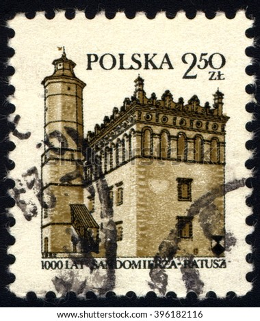 SINGAPORE - MARCH 26, 2016: A stamp printed in Poland shows Guildhall in Sandomierz Millenium, circa 1980 - stock photo
