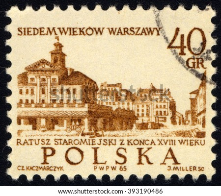 SINGAPORE - MARCH 20, 2016: A stamp printed in Poland to commemorate 700th Anniversary of Warsaw shows Old Town Hall, circa 1965 - stock photo