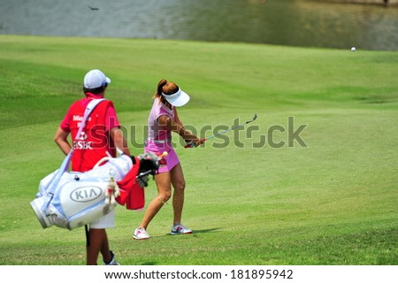 SINGAPORE - MARCH 2: American player Michelle Wie strike the ball at hole 18 during HSBC Women's Champions at Sentosa Golf Club Serapong Course March 2, 2014 in Singapore