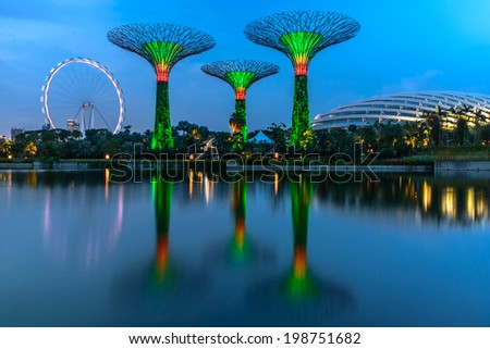 SINGAPORE - MARCH 28: Gardens by the Bay on March 28, 2014 in Singapore. Gardens by the Bay was crowned World Building of the Year at the World Architecture Festival 2012  - stock photo