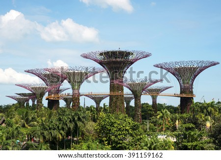Singapore-March,2015.Gardens by the Bay,steel constructions in the form of trees, called Super Trees with chinese garden and footbridges for tourists.Editorial. Horizontal view - stock photo