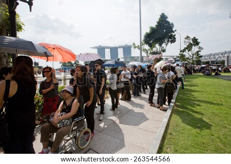 SINGAPORE - MARCH 24:  Lines of people  queuing up to pay last respect to the late Mr Lee Kuan Yew,ex prime minister of Singapore,lying in state at the parliament house. Mar 24, 2015, Singapore. - stock photo
